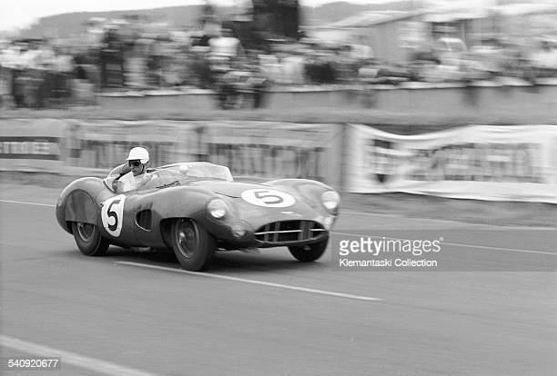 The Le Mans 24 Hours Le Mans June 2021 1959 Roy Salvadori takes a close look at his pit as he races past the tribunes in the Aston DBR1