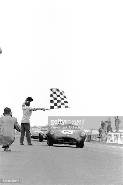 The Le Mans 24 Hours Le Mans June 2021 1959 The Final Victory Carroll Shelby brings the Aston DBR1 under the checker as Jacques Loste gives his...