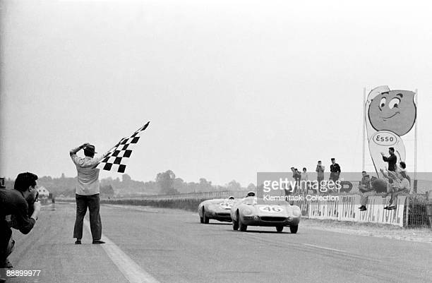 The Le Mans 24 Hours, Le Mans, June 20-21, 1959. The little Deutsch-Bonnet HBRs cross the finish line in 9th and 11th positions. The lead car, driven...
