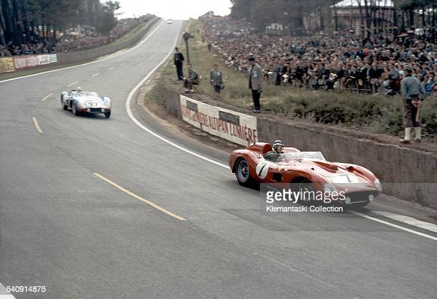 The Le Mans 24 Hours Le Mans June 2223 1957 Early in the race the Ferrari 335S of Mike Hawthorn who shared this car with Luigi Musso dives into the...