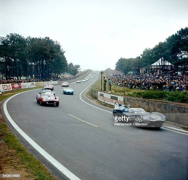 The Le Mans 24 Hours Le Mans June 2223 1957 Just after the start the field streams down into the Esses Leading here is the Jaguar Dtype from Ecurie...