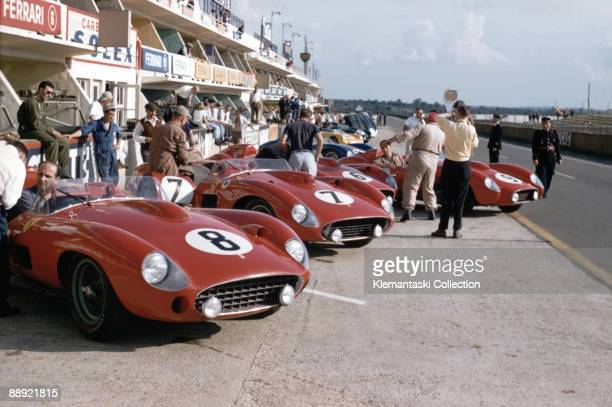 The Le Mans 24 Hours Le Mans June 2223 1957 The Ferrari team assembles in the pits before the first practice session The cars ate the 38 liter 315S...