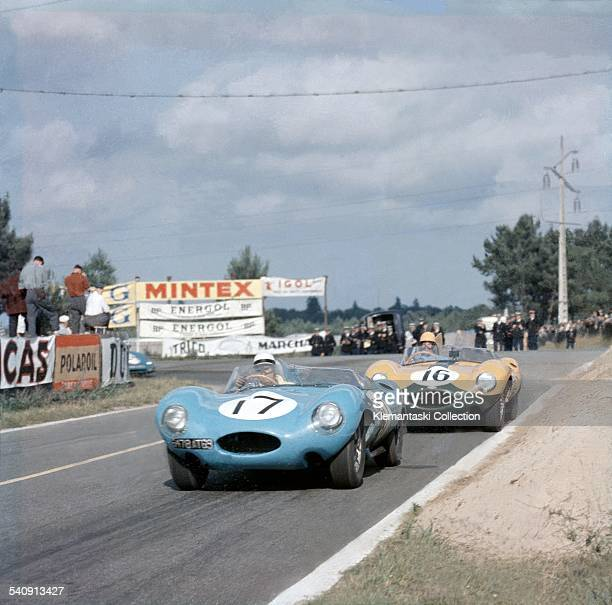 The Le Mans 24 Hours Le Mans June 2223 1957 Two Jaguar Dtypes accelerate out of Mulsanne Corner past the signaling pits N 17 was driven by Jean Lucas...