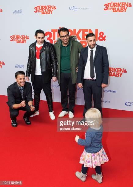 The lead actors baby Carla Kostja Ullmann Eko Fresh director Sinan Akkus and actor Kida Khodr Ramadan arrive for the premiere of their new film...