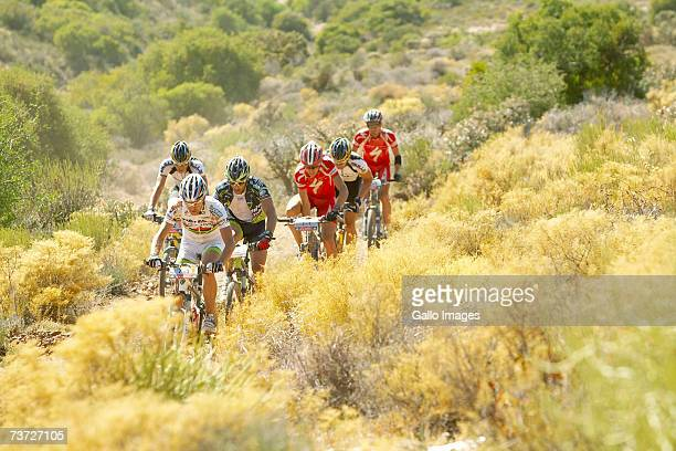 The lead bunch is lead by stage winner Ralph Naef through the Klein Karoo during stage four of the 2007 Absa Cape Epic Mountain Bike stage race from...