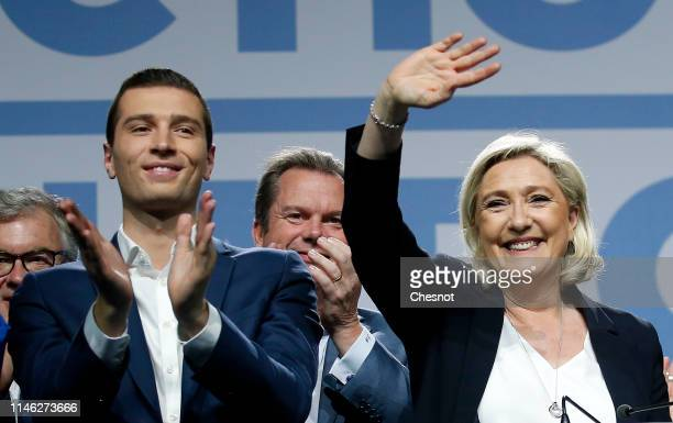 The lead candidate for Marine Le Pen's rightwing populist National Rally Jordan Bardella and President of the NR Marine Le Pen gesture to the crowd...