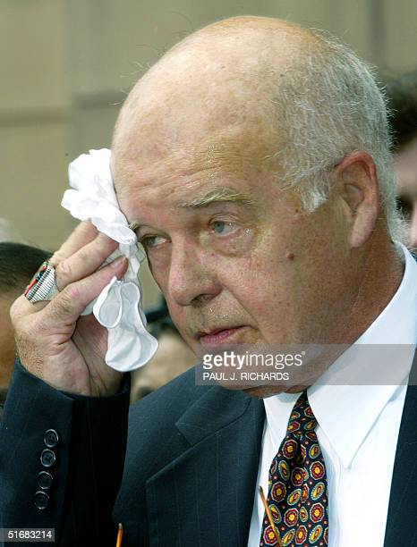 The lead defense attorney for American Taliban John Walker Lindh James Brosnahan wipes his brow as he briefs the media outside the Albert V Bryan US...