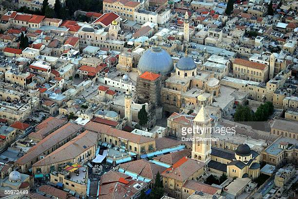 The lead domes of the Church of the Holy Sepulchre are flanked by Christian church steeples and Islamic mosque minarets October 20 2005 in this...