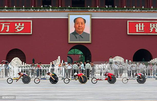 The lead group in the marathon goes past the Forbidden City at Tiananmen Square during Day 11 of the 2008 Paralympic Games on September 17, 2008 in...