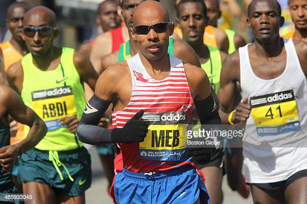 The lead men including Mebrahtom Keflezighi of the United States approach Mile 1 in Hopkinton during the 118th Boston Marathon on Monday April 21...