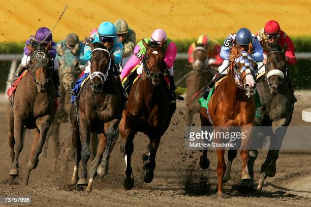 The lead pack heads out of turn four during the 56th Running of the Florida Derby at Gulfstream Park March 31 2007 in Hallendale Florida Scat Daddy...
