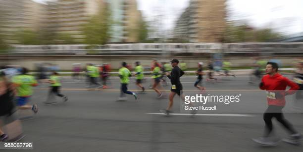 TORONTO ON MAY 13 The lead runners approach the 2 kilometre marker near the Kay Gardner Beltline Park bridge The Sporting Life 10 K drew over 22000...