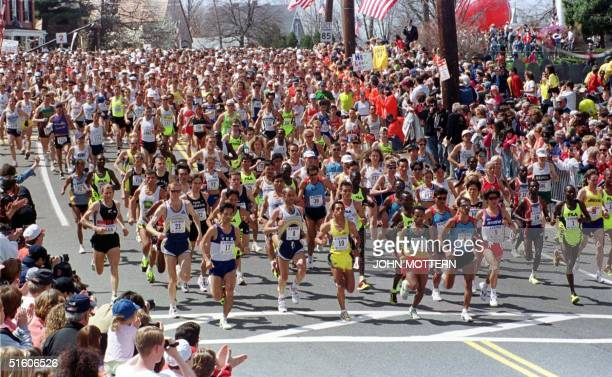 The lead runners are cheered on by fans at the start of the 103rd running of the Boston Marathon 19 April 1999 in Hopkinton Massachusetts The...