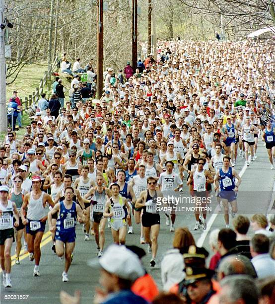 The lead runners cruise down the first hill after the start of the 103rd running of the Boston Marathon 19 April 1999 in Hopkinton Massachusetts This...