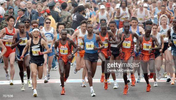 The lead runners take off April 15, 2002 at the start of the 106th Boston Marathon in Hopkinton, MA. Although Koreas Lee Bong Ju was considered the...