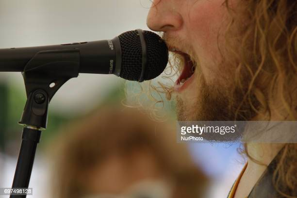 The lead singer of a youth metal band is seen performing during a bearwearer gathering competition is seen in Bydgoszcz Poland on 18 June 2017