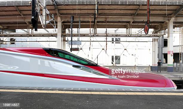 The lead vehicle of the new 'E6' Type Akita Shinkansen 'Super Komachi' is seen at the platform during a press preview at JR Omiya Station on January...