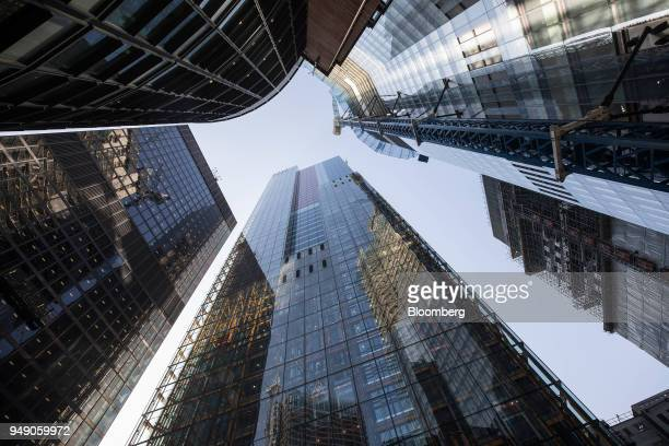 The Leadenhall building also known as the 'Cheesegrater' center St Helen's the commercial skyscraper housing the headquarters of Aviva Plc left and...