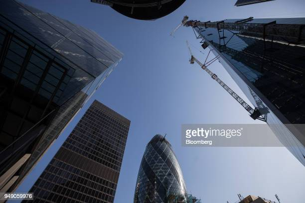 The Leadenhall building also known as the 'Cheesegrater' left St Helen's the commercial skyscraper housing the headquarters of Aviva Plc second left...