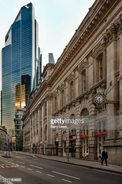 The Leadenhall Building towers over the Royal Exchange on Cornhill at 730am during the coronavirus pandemic on the 24th April 2020 in London United...
