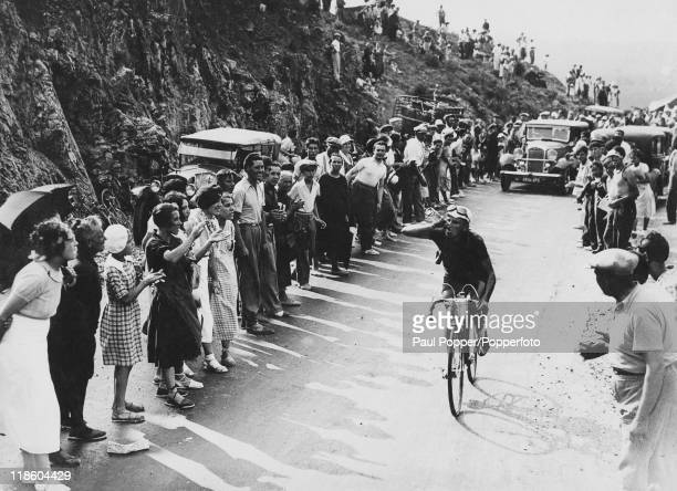 The leader in the 14th stage of the Tour de France takes a drink about ten kilometres from Perpignan circa 1935