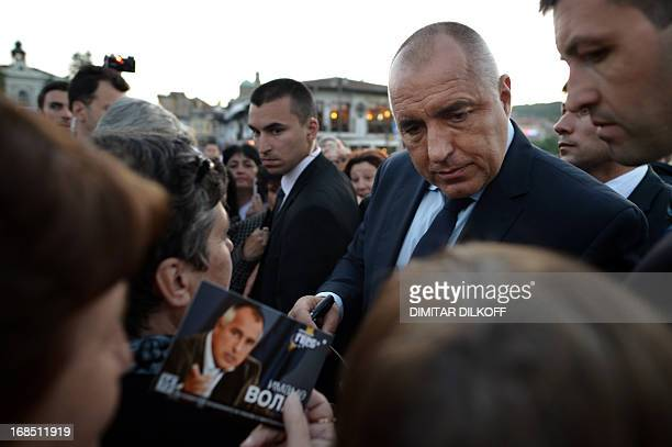 The leader of conservative GERB party and former Prime Minister Boyko Borisov signs autographs for his supporters during a preelection rally in the...