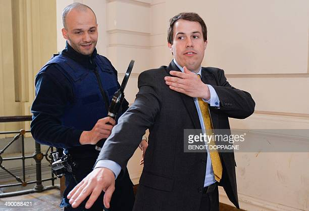 The leader of Debout Les Belges farright lawmaker and chamber member Laurent Louis performs the controversial 'quenelle' gesture while going through...