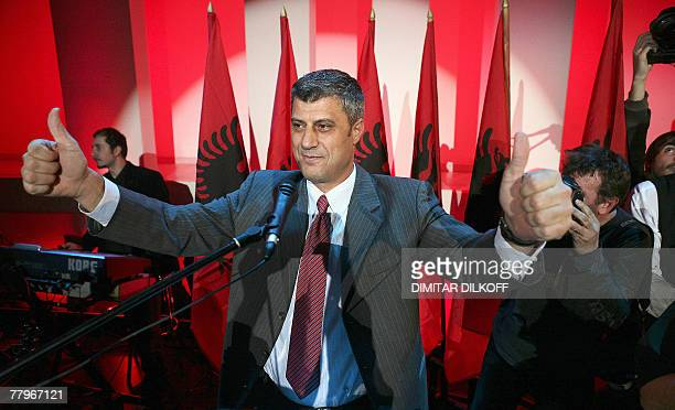 The leader of Democratic Party of Kosovo Hashim Thaci greets his supporters after claiming victory in Kosovo's parliamentary election early 18...