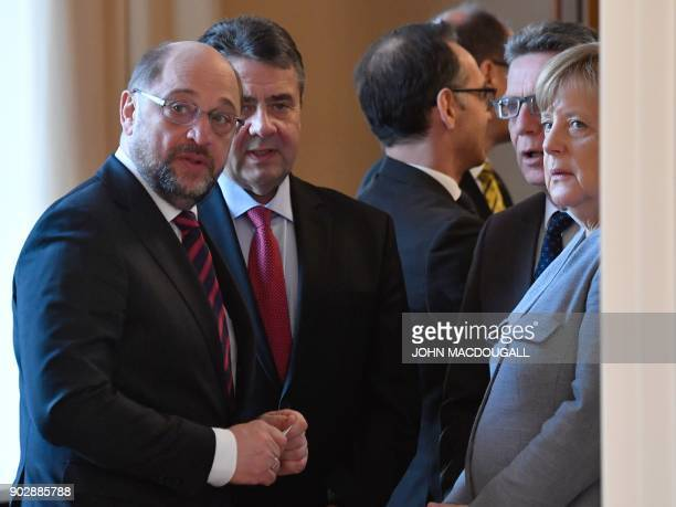 The leader of Germany's social democratic SPD party Martin Schulz German Vice Chancellor and Foreign Minister Sigmar Gabriel and German Chancellor...