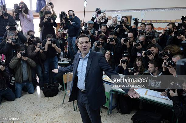 The leader of Greece's left-wing Syriza party Alexis Tsipras poses prior to cast his ballot at a polling station in Athens on January, 2015. Greece...