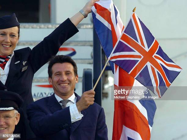 The leader of London's bid to stage the Olympic Games in 2012 Lord Coe waves the flag as he flies to Singapore