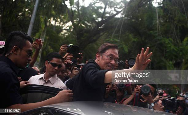 The leader of Pakatan Rakyat Anwar Ibrahim waves to his supporters as he leaves during the Black 505 Rally on June 22 2013 in Kuala Lumpur Malaysia...