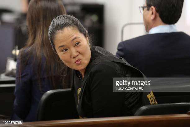 The leader of Peruvian opposition party Fuerza Popular Keiko Fujimori gestures during an appeals hearing in Lima on October 17 2018 A Peruvian...