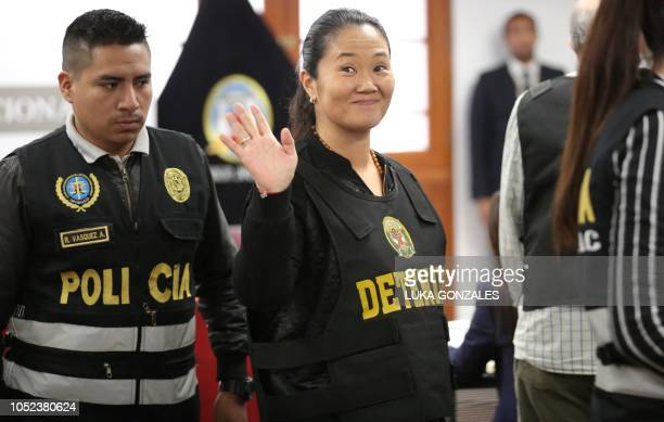 The leader of Peruvian opposition party Fuerza Popular Keiko Fujimori waves during an appeals hearing in Lima on October 17 2018 A Peruvian tribunal...