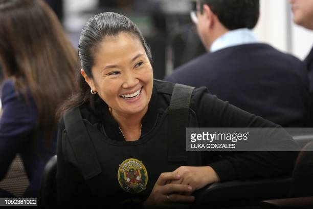 The leader of Peruvian opposition party Fuerza Popular Keiko Fujimori smiles during an appeals hearing in Lima on October 17 2018 A Peruvian tribunal...