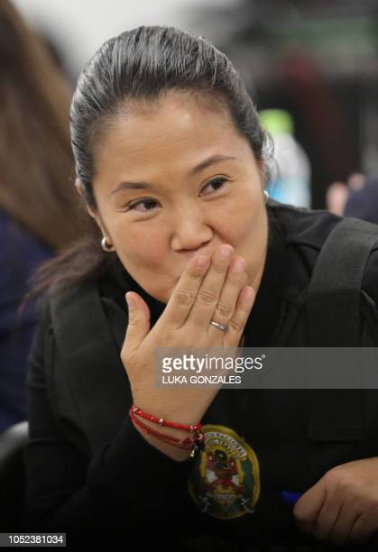 The leader of Peruvian opposition party Fuerza Popular Keiko Fujimori blows a kiss during an appeals hearing in Lima on October 17 2018 A Peruvian...