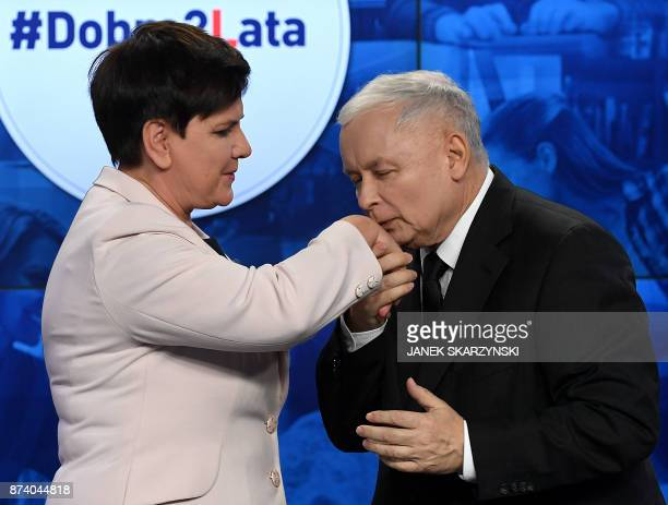 The leader of Poland's ruling party Law and Justice Jaroslaw Kaczynski kisses the hand of Polish Prime Minister Beata Szydlo during a press...