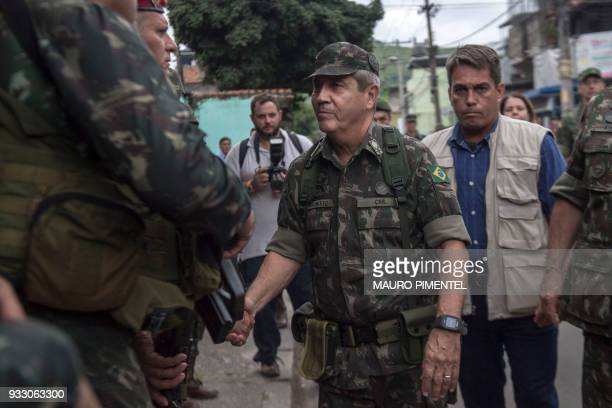 The leader of Rio's Security Federal Intervention General Walter Souza Braga Netto is pictured during an operation at Vila Kennedy favela in Rio de...