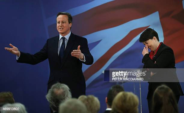 The leader of Scottish Conservatives Ruth Davidson laughs with British Prime Minister David Cameron as they launch the Scottish conservative election...