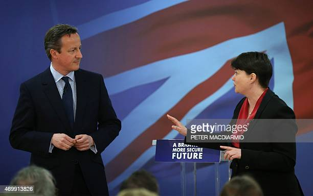 The leader of Scottish Conservatives Ruth Davidson speaks with British Prime Minister David Cameron as they launch the Scottish conservative election...