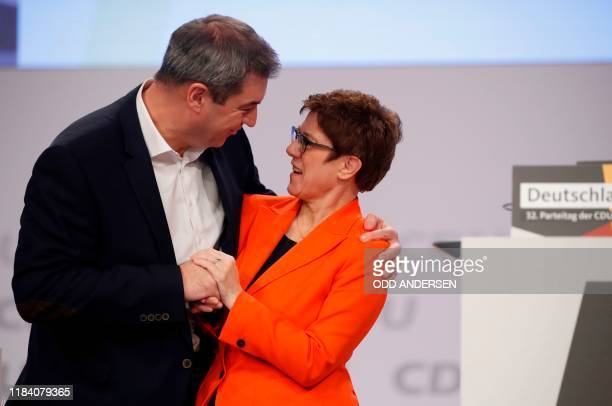 The leader of the Christian Democratic Union Annegret KrampKarrenbauer acknowledges Markus Soeder leader of the conservative Christian Social Union...
