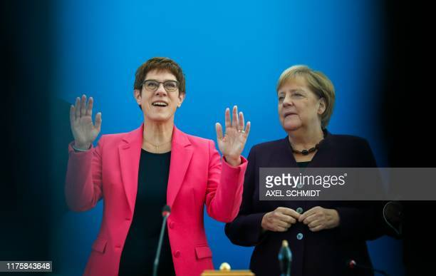 The leader of the Christian Democratic Union Annegret Kramp-Karrenbauer and German Chancellor Angela Merkel arrive at the beginning of their party's...