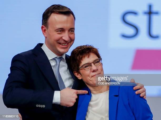 The leader of the Christian Democratic Union Annegret Kramp-Karrenbauer and the Secretary General of the Christian Democratic Union Paul Ziemiak hug...