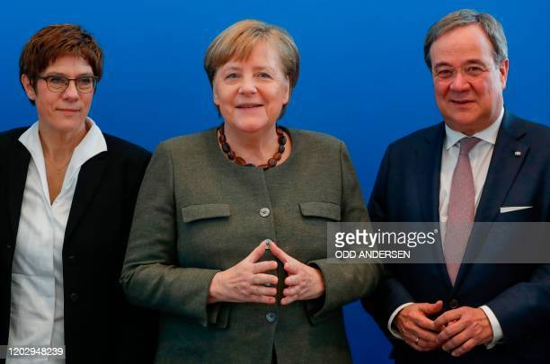 The leader of the Christian Democratic Union Annegret KrampKarrenbauer German Chancellor Angela Merkel and North RhineWestphalia's State Premier and...