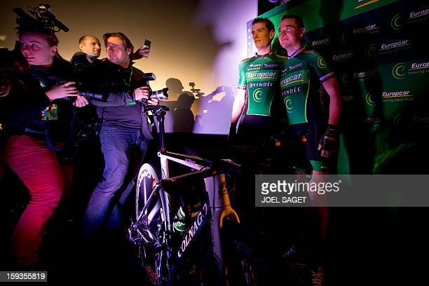 The leader of the Europcar cycling team France's Thomas Voeckler poses next to his teammate Pierre Rolland during the presentation of the team on...
