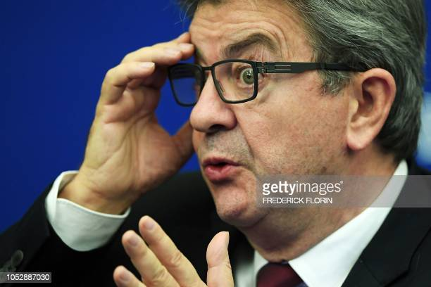 TOPSHOT The leader of the farleft party France Insoumise JeanLuc Melenchon speaks during a press conference on the subject Our convergence at the...