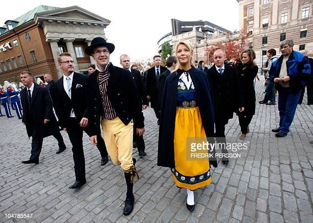 The leader of the farright Sweden Democrats party Jimmie Akesson and his girlfriend Louise Erixson wear traditional costumes on October 5 2010 on...
