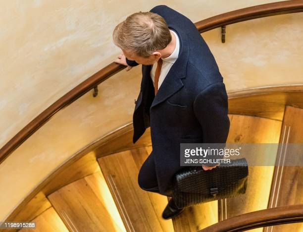 The leader of the Free Democratic Party Christian Lindner leaves after a press conference at a hotel in Erfurt eastern Germany shortly after the...
