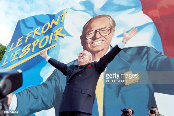The leader of the French Farright Front National party JeanMarie Le Pen acknowledges the supporters on September 28 1996 during the annual political...