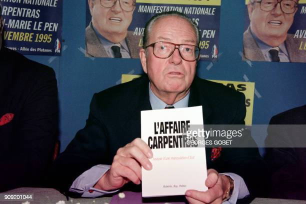 The leader of the French farright National Front party JeanMarie Le Pen displays on November 11 1995 a book 'The case of Carpentras' which speaks of...
